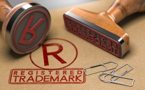 3D illustration of two rubber stamps with the text registered trademark. Trade-mark registration in Australia concept