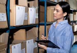 Woman doing an inventory in a reverse logistics company