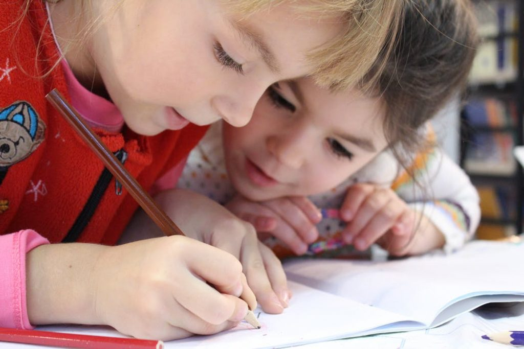 Two little girls during a drawing activity