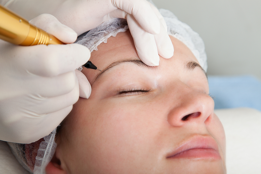 Woman getting an eyebrow feathering treatment