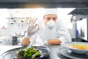 Chef wearing PPE for the hospitality industry
