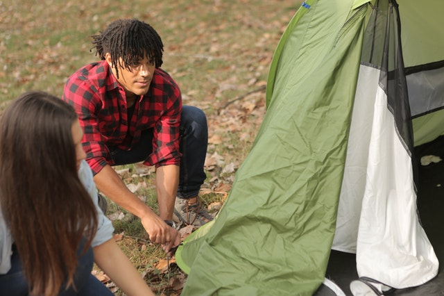 Couple setting up the best hiking tent